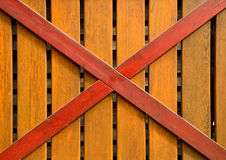 Barrière de Wodden avec la croix Photographie stock libre de droits