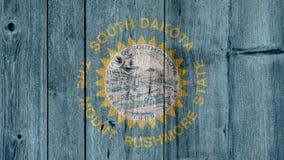 Barrière en bois de drapeau du Dakota du Sud d'état d'USA photographie stock libre de droits