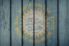 Barrière en bois de drapeau du Dakota du Sud d'état d'USA images libres de droits