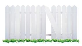 Barrière et herbe en bois Photographie stock libre de droits