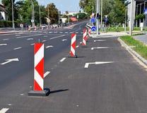 Barrières de route sur la rue photo stock