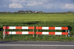 Barricade. Between country road and fields stock photography