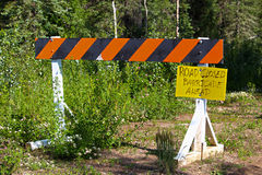A barricade with a handwritten sign that the road is closed Royalty Free Stock Images