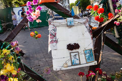 Barricade on the Instytutska str., Kyiv, Ukraine. KIEV, UKRAINE - May 23, 2014: Barricade on Instytutska street still stand and decorated with icons; flowers royalty free stock image