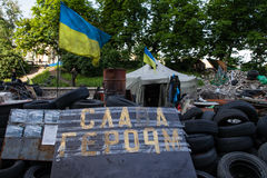 Barricade on the Instytutska str., Kyiv, Ukraine. KIEV, UKRAINE - May 23, 2014: Barricade, tires and tent with protesters on the Instytutska str stock images