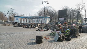 Barricades of the street - Euromaidan revolution. KIEV, UKRAINE - MARCH 22, 2014: People visiting barricades in front of entrance to the Dinamo Kiev Stadium stock footage