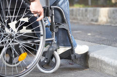 Barrier. Man on a wheelchair who came to a bareer Royalty Free Stock Photography