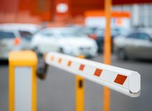 Barrier against the background of car parking stock images