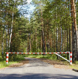 Barrier blocking road in woods Stock Photos