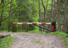 Barrier, blocking the road into the woods Royalty Free Stock Image