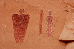 Barrier Canyon Pictograph. Three ancient Barrier Canyon style pictograph figures on red sandstone in desert southwest Royalty Free Stock Image