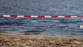 Barrier caution tape on bathing lake. No continuity stock video