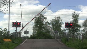 Barrier coming down, level crossing stock video