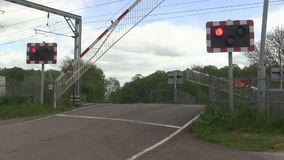 Barrier coming down at a level crossing. stock footage