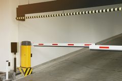 Barrier at the Entrance to the Parking Garage. Building royalty free stock photo