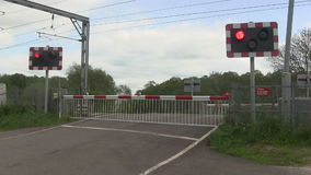 Barrier going up ata level crossing stock footage