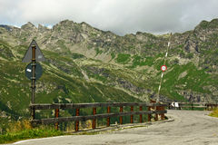 Barrier meandering mountain road Royalty Free Stock Photo