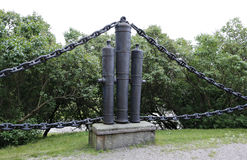 The barrier of the old bronze cannon and marine chains Royalty Free Stock Image