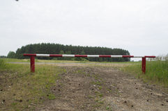 The barrier, overlapping entry into the forest. Photo on the wooden barrier red-white color, closing the entry to the forest vector illustration