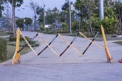 Barrier of a park. Close the street Stock Photo