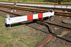 Barrier at the railway track Stock Images