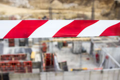 Barrier red and white tape. To mark construction site royalty free stock images