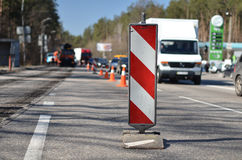 Barrier repairs road and workers. On background traffic Royalty Free Stock Image