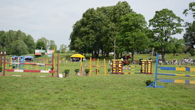 Barrier rider horse race. Barriers in steeplechase horse race with obstacles and rider jumping though them stock video