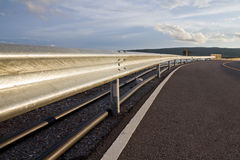Barrier roadside. Barrier along the road on the dam stock photography