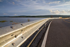 Barrier roadside. Barrier along the road on the dam royalty free stock photography