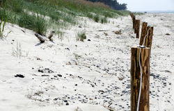 Barrier before a sand dune Stock Photography
