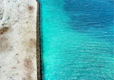 Barrier separating the white sand and the turquoise maldivian sea royalty free stock image