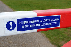 Barrier on small road with instructions. Royalty Free Stock Photography