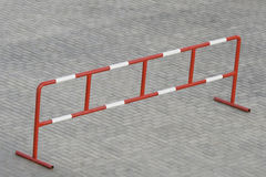 Barrier standing on the stone block paving. Metal barrier standing on the grey stone block paving Stock Photography