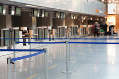 Barrier tape at airport. Barrier tape at the airport in front of check in counter Royalty Free Stock Photos