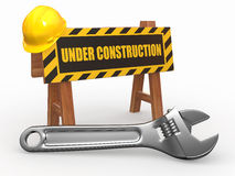 Barrier with text under construction and hardhat Stock Images