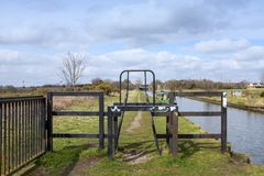Barrier on towpath limiting vehicle and speed access in Cheshire. Barrier on public footpath or towpath to control traffic speed next to the Trent and Mersey Royalty Free Stock Photography