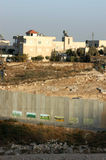 Barrier Wall in Jerusalem. September 20, 2006 - A distant view of the Barrier Wall being built by Israel, as it stands in Jerusalem. The wall divides many Royalty Free Stock Photography