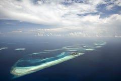 Barriera corallina ed atollo Immagine Stock