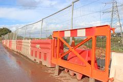 Barriers on a construction site. Barriers and fence on a road construction site Royalty Free Stock Image