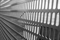 Barriers. A metal barrier with small holes. Perspective that extends off-scene Royalty Free Stock Photo