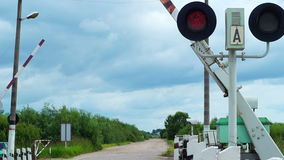 Barriers opening on railroad crossing. Barriers are opening while stop lights blinking on railroad crossing stock footage