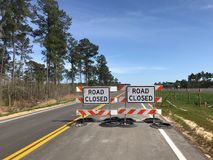 Road Closed!. Barriers set up designate the road is closed from that point on royalty free stock photo