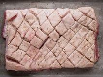 Barriga de carne de porco temperado cru crua de Ustic imagem de stock royalty free