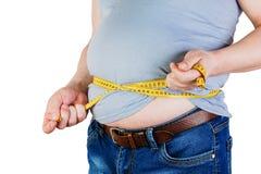 A barriga de um homem gordo isolado no fundo branco HOL gordo do homem fotos de stock royalty free