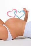 Barriga do close-up da mulher gravida Gênero: menino, menina ou gêmeos? Fotos de Stock Royalty Free