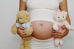 Barriga grávida - menino ou menina? Fotos de Stock