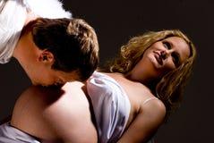 Barriga grávida de beijo do homem Imagem de Stock