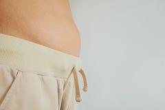 A barriga magro do indivíduo do close-up, com espaço branco da cópia barriga fotografia de stock