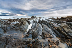 Barrika beach with blue clouds Stock Image